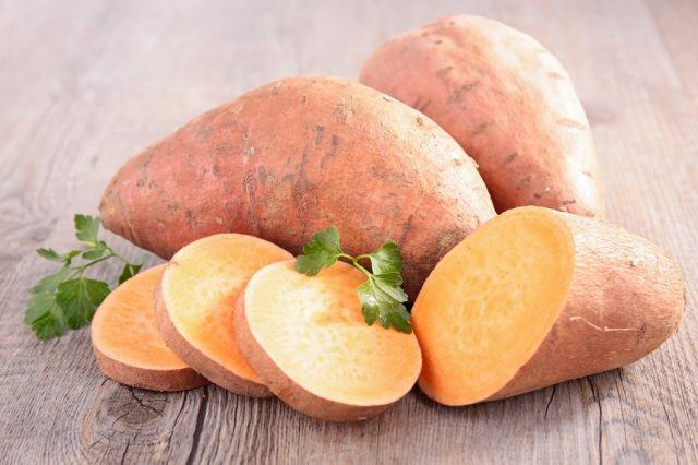 Sweet potato on a wooden table.