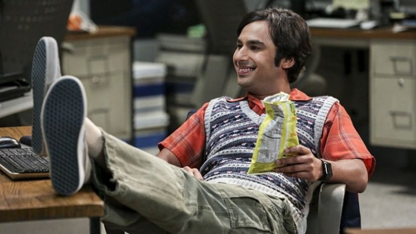 Raj leans back in his chair with his feet up on a desk in The Big Bang Theory