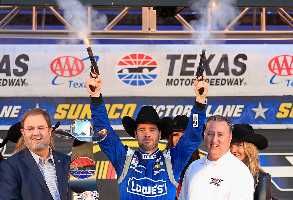 Jimmie Johnson shoots smoking pistols in the air