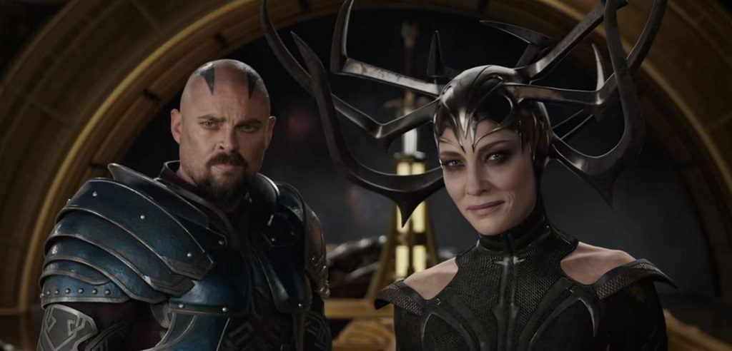 Skurge and Hela stand together in their armor in Thor: Ragnarok