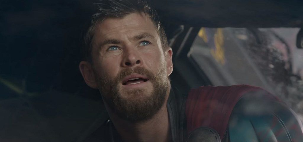 Thor opens his mouth to speak while looking up.