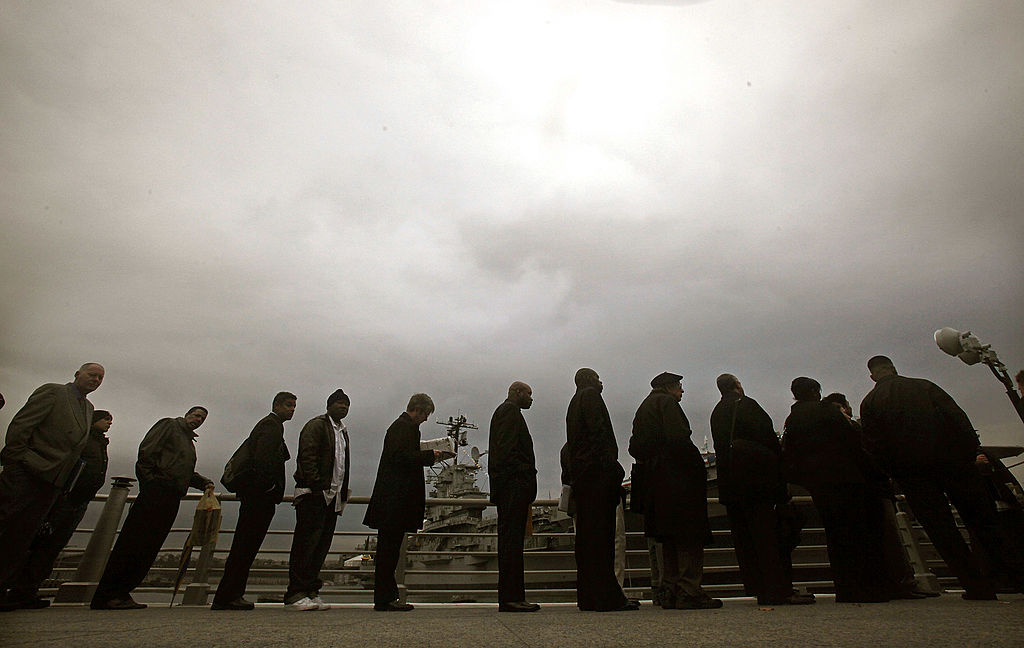 Job applicants stand in line at a career fair