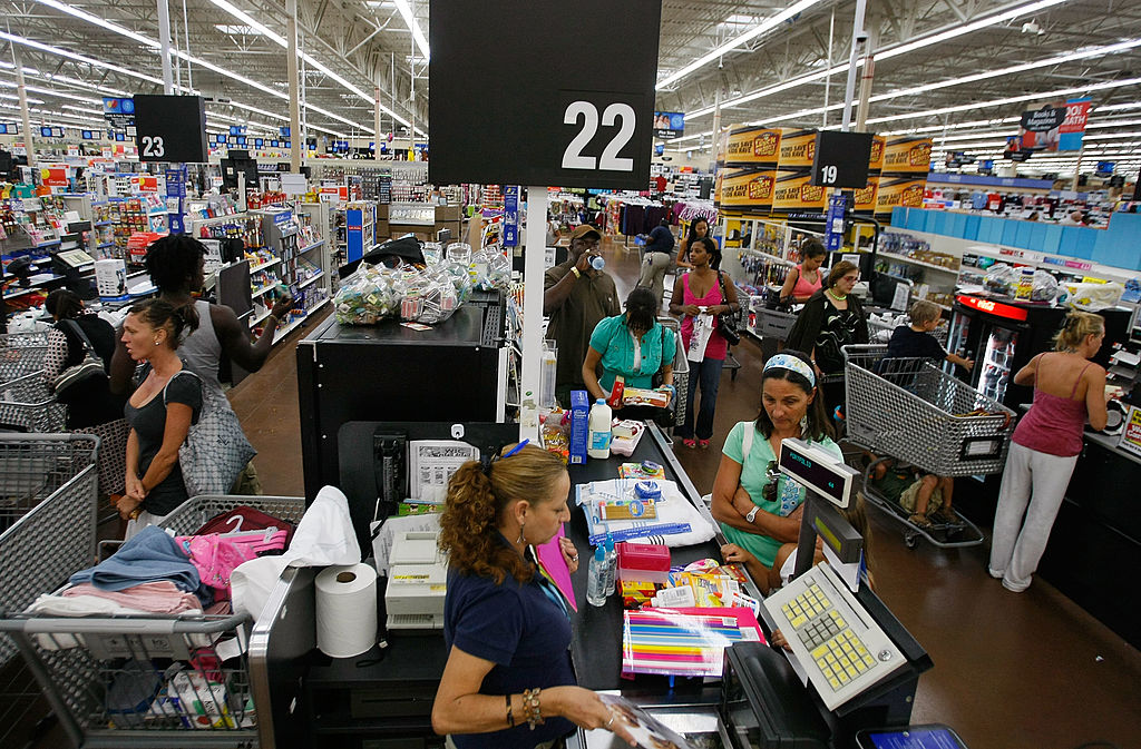People make their way through the checkout as they make purchases at a Wal-Mart Store
