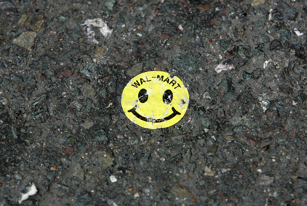 A Walmart sticker is seen on the ground