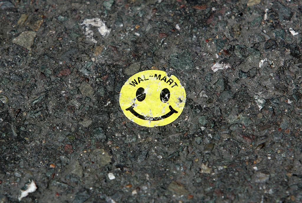 A Walmart sticker is seen on the ground
