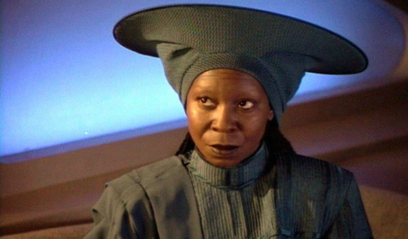 Whoopi Goldberg wears a blue uniform on Star Trek: The Next Generation.