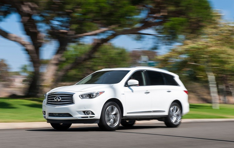 Road shot of white 214 Infiniti QX60 Hybrid