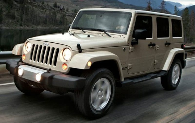 Road shot of tan Jeep Wrangler Unlimited from 2014 model year