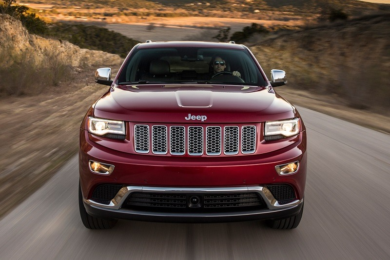 Front view of maroon Jeep Grand Cherokee on the road