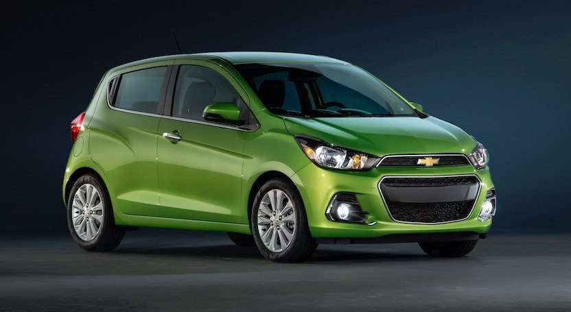 Look at a green Chevy Spark from front three-quarter view.