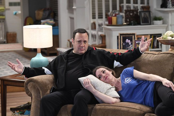 Erinn Hayes lays on a pillow on Kevin James' lap in Kevin Can Wait Season 1
