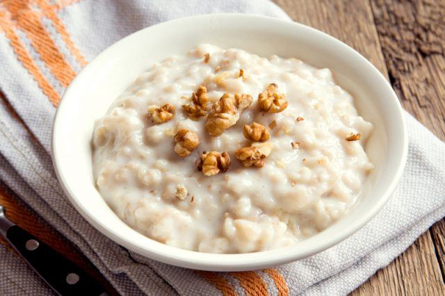 A bowl of oatmeal on a plate.