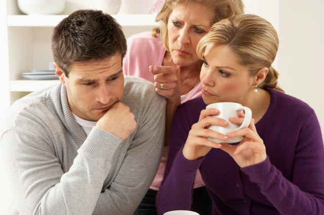 Man being scolded by woman and mother