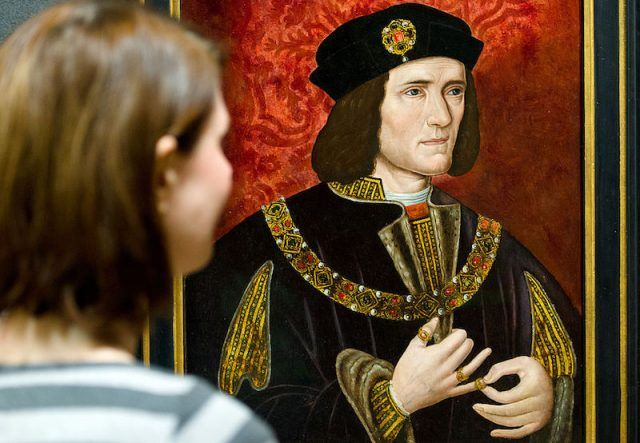 A woman looks at a painting of Britain's King Richard III.