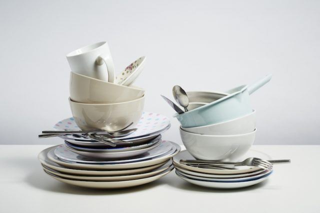 A pile of dishes ready to be washed