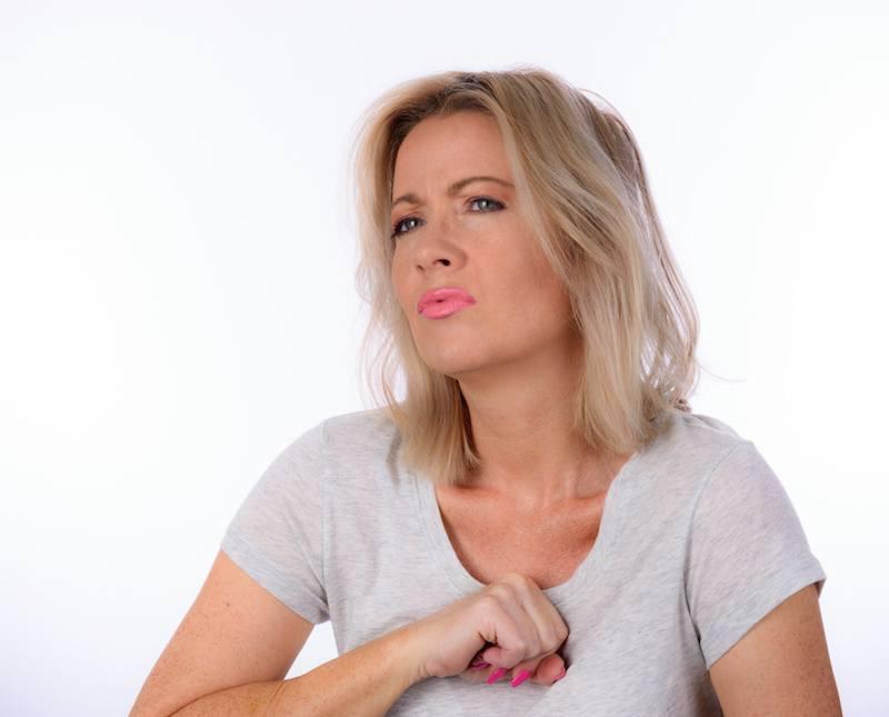 woman with heartburn