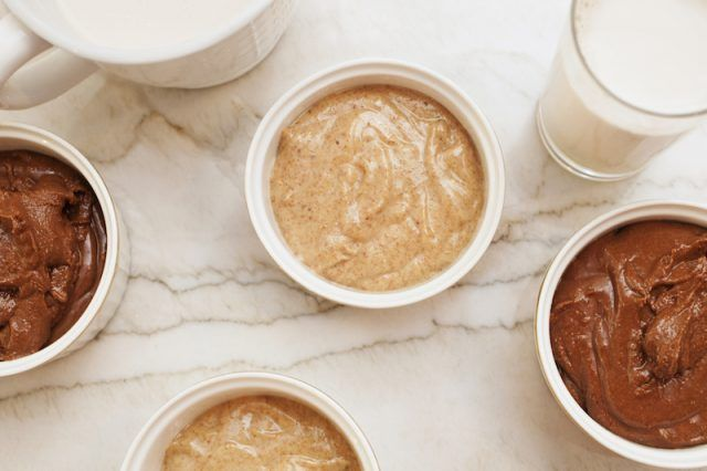 An assortment of almond butters on a white table.