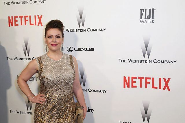 Alyssa Milano poses in a gown at an event in LA.