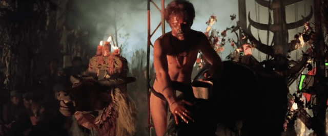 A man in underwear performs an animal sacrifice in Apocalypse Now