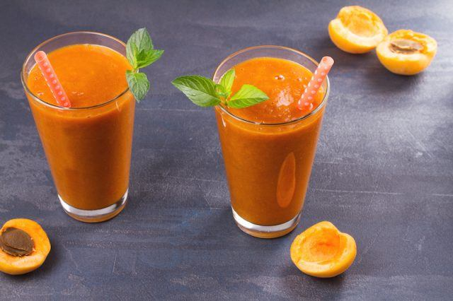 Two glasses of delicious apricot smoothies.