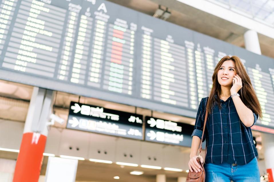 Beautiful Asian woman traveler on mobile phone call