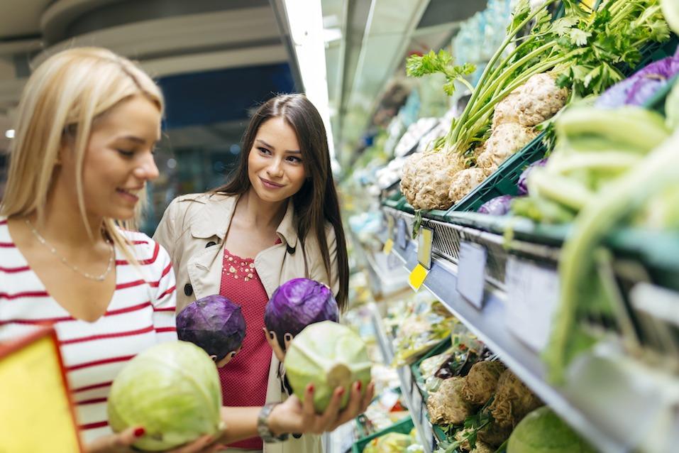 Women comparing produce