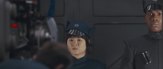 Rose and Finn emerging from an elevator in uniform in Star Wars: The Last Jedi