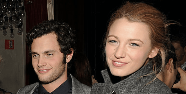 Blake Lively and Penn Badgley smile together at an event.