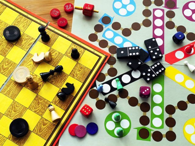 Board games set up on a wooden table.
