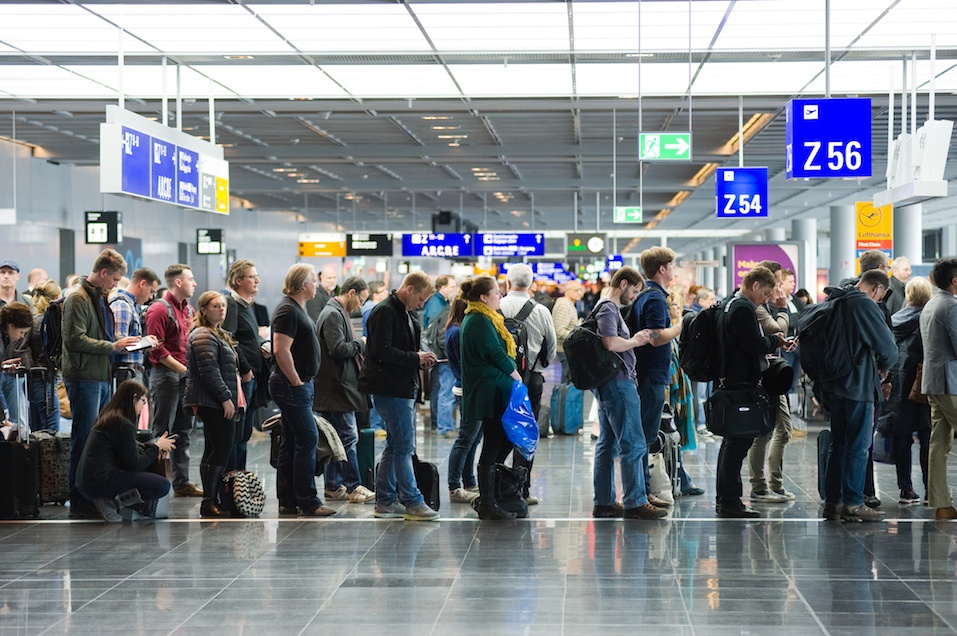 Passengers waiting in a row for boarding on an airport to a flight to America