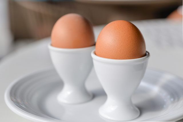 Two boiled eggs on a table.