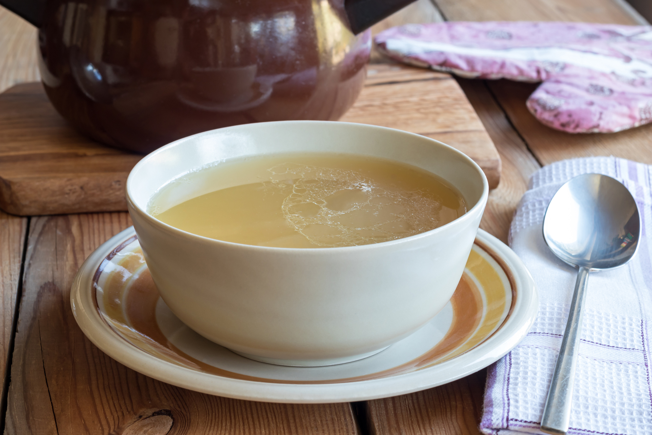 Bone broth made from chicken served in a soup bowl