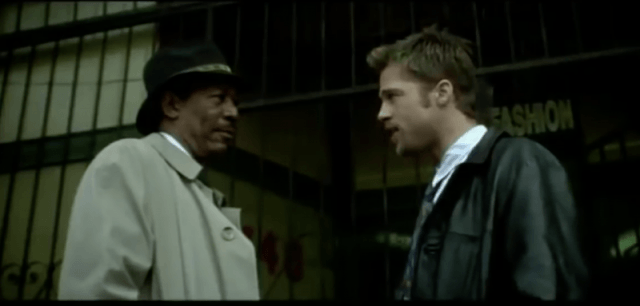 Brad Pitt and Morgan Freeman stand outside and face each other in Seven
