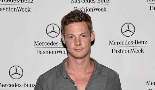 Brandon Jones poses for photos during New York Fashion Week.
