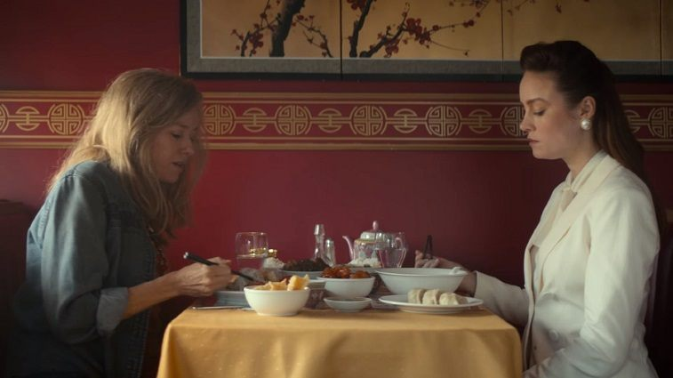 Naomi Watts as Rose Mary Walls and Brie Larson as Jeannette Walls sitting at a table eating in a restaurant in The Glass Castle