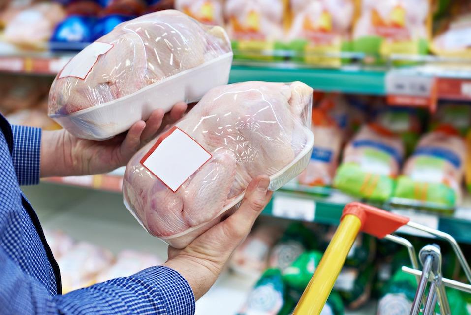 Buyer of chicken meat in shop