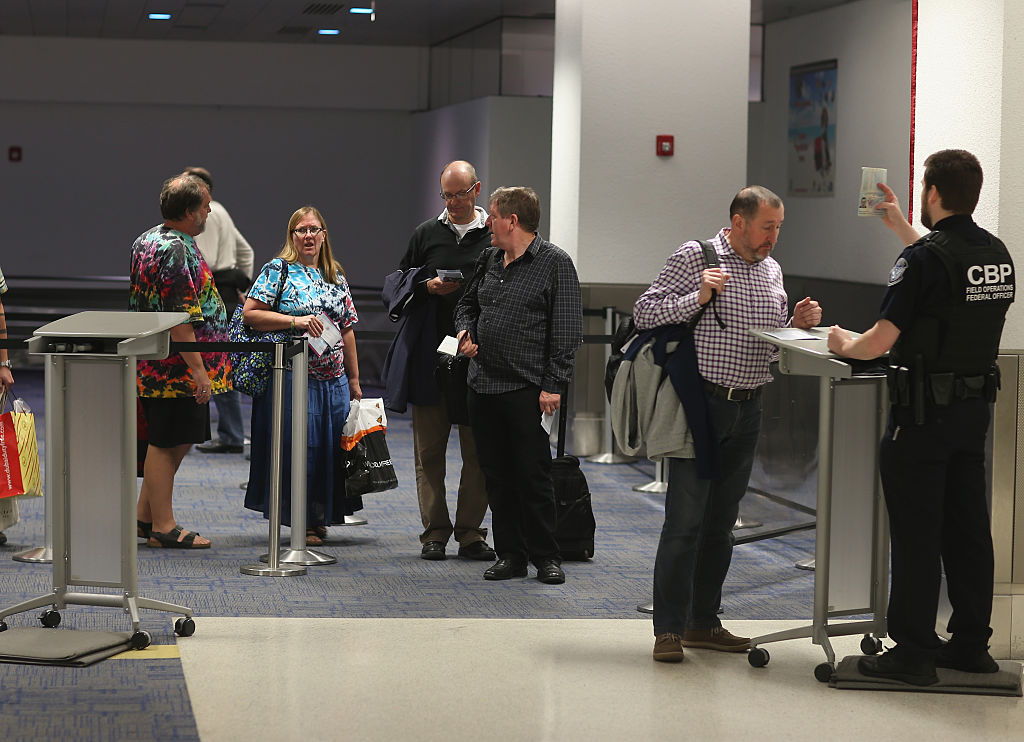 Passengers clear through a U.S. Customs and Border Protection check point