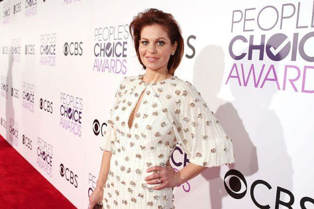 Candace Cameron poses for photos on the red carpet of the People's Choice Awards.