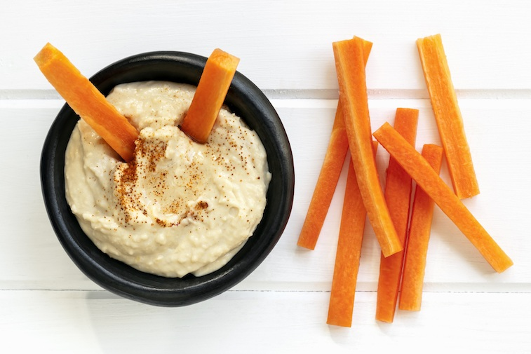 Carrots and hummus make a delicious and healthy snack.