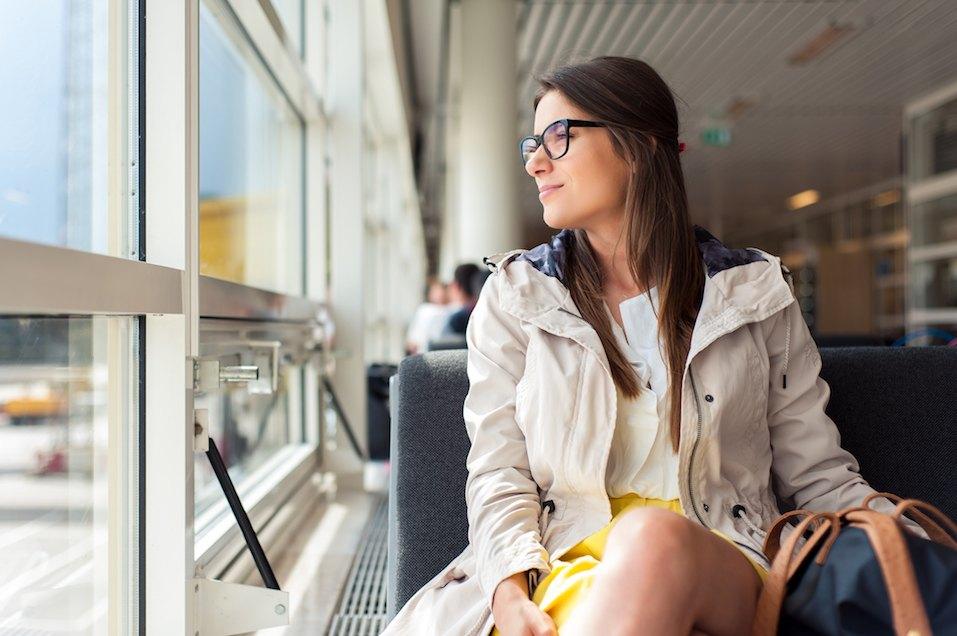 Woman waiting her flight at airport terminal