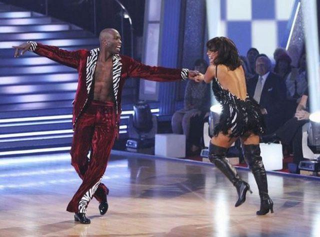 Cheryl Burke and Chad Ochocinco dance together on the 'Dancing with the Stars' dance floor.