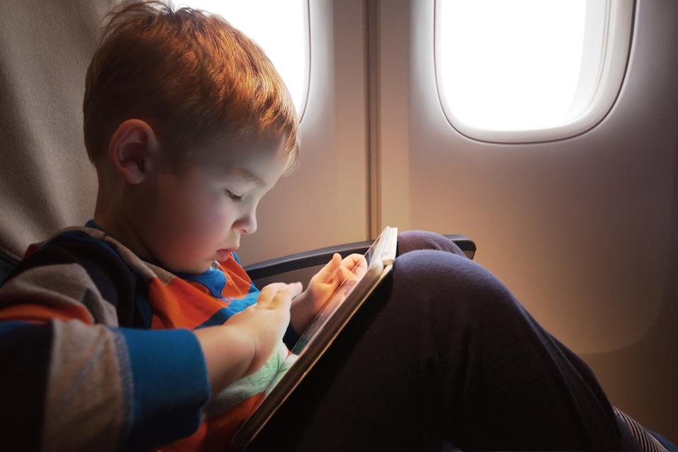 Little child with tablet computer on the lap