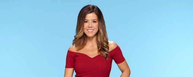 Christen in a red top and behind a blue background.