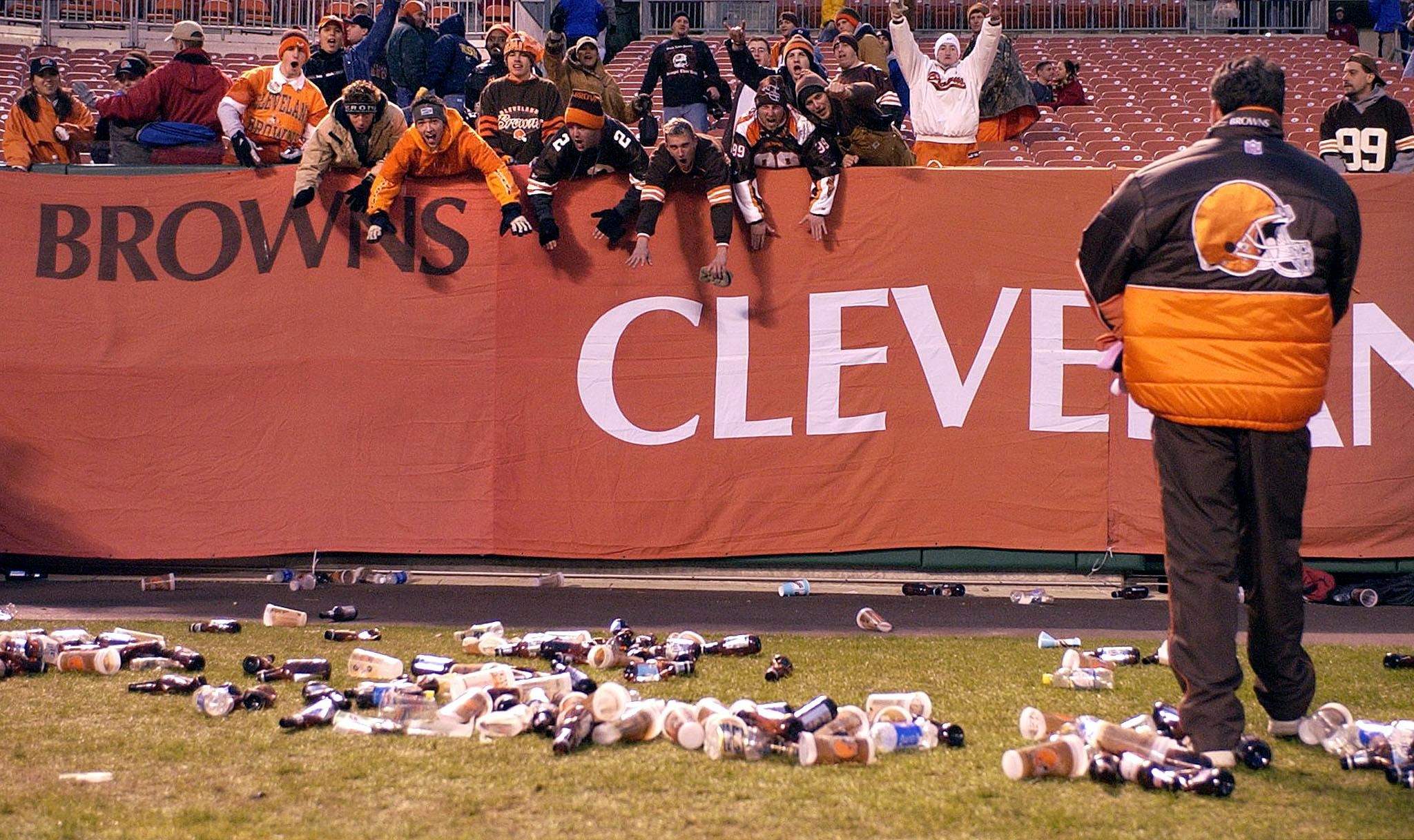CLEVELAND, UNITED STATES: Bottles and debris litter the field at Cleveland Browns Stadium in Cleveland, Ohio, as frustrated Brown fans defy a referee's call during the Cleveland Browns-Jacksonville Jaguars NFL game 16 December, 2001. Fans began to throw beer bottles and debris onto the field after a first-down catch by the Browns was reversed and the ball given to the Jacksonville Jaguars with 48 seconds left in the game. Officials stopped the game, but later brought both teams back to play the remaining 48 seconds. Jacksonville defeated Cleveland 15-10. AFP Photo/David Maxwell (Photo credit should read DAVID MAXWELL/AFP/Getty Images)