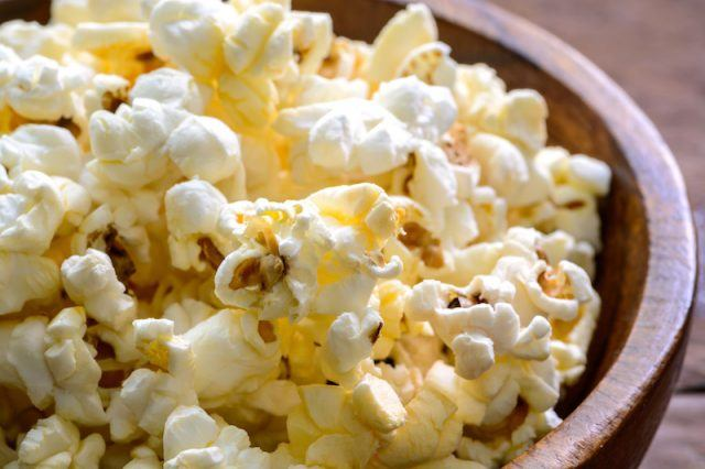 Buttered popcorn in a wooden bowl