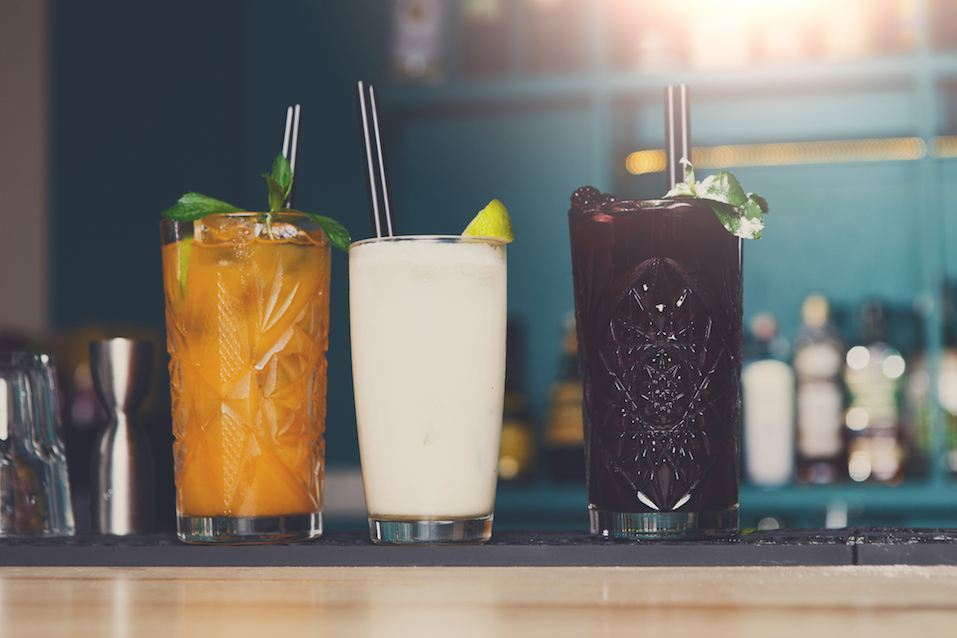 Creative exotic alcoholic cocktails in bar