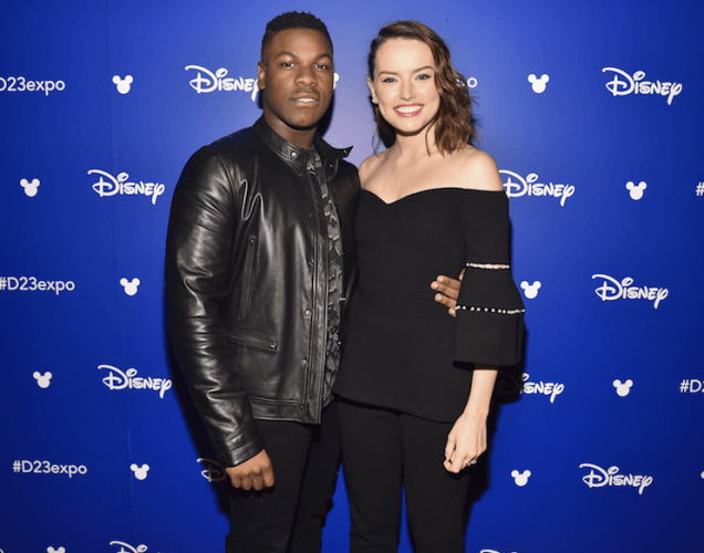 John Boyega poses with Daisy Ridley at the Star Wars Celebration Day event.