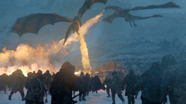 Daenerys' dragons blow fire during a battle