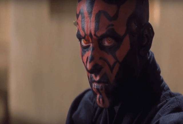 Death Maul turns his head and stares to the side.