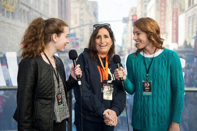 Deena Katz being interviewed by two reporters at the LA Women's March.